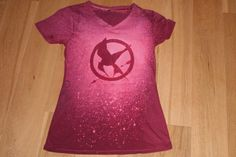 Check it!! I made my Mockingjay shirt today!!! :D I LOVE how it came out! :D Many thanks to my sis for painstakingly cutting out the Mockingjay stencil. :)  Made it using this tutorial: http://www.sixsistersstuff.com/2012/01/diy-bleach-t-shirt-tutorial-perfect.html
