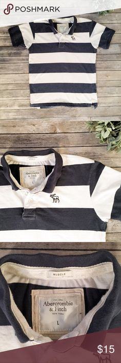 """Abercrombie & Fitch Mens Guys Striped Polo Shirt L Dark blue and white wide stripes, with the classic moose embroidered logo. Super soft fabric, on the thicker side.   ▪️Approx measurement.....Chest- 40""""  ▪️ Fabric-100% cotton ▪️ Condition-a bit of fading, but no holes or stains.  ▪️ Preppy, hipster, muscle, rugby, varsity  Offers welcome Abercrombie & Fitch Shirts Polos"""