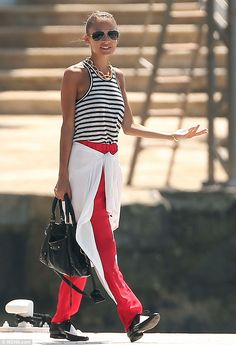 Nicole stands out in a striped top and red trousers as she holidays in the South of France