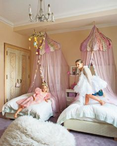 In the Manhattan home of cosmetics maven Jeanine Lobell and actor Anthony Edwards, daughters Poppy, 8, and Wallis, 10, in their bedroom, which features canopies from ABC Carpet & Home and a faux-fur pouf.