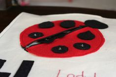 Ladybug with button spots and zipper pocket.  Lots of motor skills all in one page!