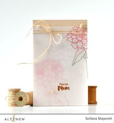 Create an interesting look for your card by using several layers of vellum with stamped images on each. Details: http://craftwalks.com/2016/04/04/altenew-celebrating-parents-card-drive-blog-hop