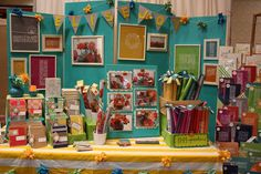 Beautiful & colorful craft fair booth. Love the yellow stripe tablecloth!
