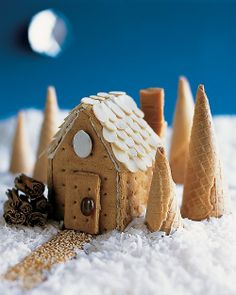 Cutest house ever with a little cinnamon stick woodpile.