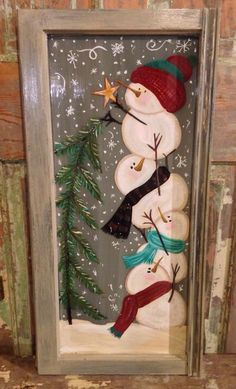 Snowmen painted on old window.