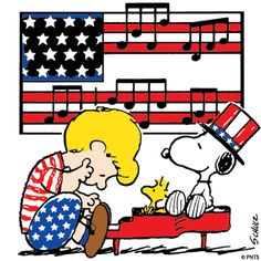 Schroeder Dressed in Red, White and Blue Playing a Red Piano With Snoopy and Woodstock Sitting on Top of Piano