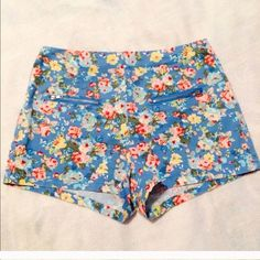 High waist floral shorts Blue floral high waisted shorts. Runs a little small. Zips in the back Mine Shorts Jean Shorts