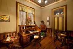 Mauve, buttercream and olive green hues set the stage in this historic office. Finely carved furnishings, including the sturdy rolltop desk, anchor the space.