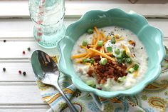 LOADED BAKED POTATO SOUP:  This basic white potato soup is creamy and delicious, the perfect base for some kickin' toppings: salty bacon, cool sour cream, sharp cheddar cheese, crunchy green onions. The recipe makes enough to feed 6-8 adults, but the recipe is quite easy to double, if you plan to make it for a party.     ingredients:  4 stalks celery, finely diced  1 large onion, very well chopped  1/2 cup butter  1/2 cup all-purpose flour  32 ounces cups chicken broth  4-6 cups whole milk  2 cup chopp...