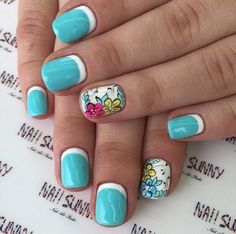 Feel the summer with bright colors no your nails. A wonderful combination of white and blue nail polish is a perfect way to depict the blue skies of summer. You can also add colorful details like flowers to make it even more interesting to look at.