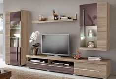 Living room is all about having a trendy TV unit. Check our latest ...