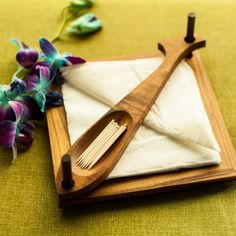 Decorate your dining table with this unique napkin holder.  Pile up your napkins tidily in this napkin holder. Napkins can be neatly placed on the wooden engraved plate.  The tooth pick holder in the shape of a fish will act as a weight to the napkins -www.cooliyo.com