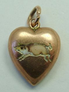 A Victorian c1900 9ct rose gold puffed (hollow) heart charm with a champleve enamel pig to the front, SO RARE and even with some damage is still very sweet. Sandys Vintage Charms, £125.00