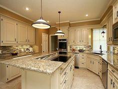 Santa Cecilia Granite White Cabinets Backsplash Ideas. Inspiration for kitchen remodeling, cabinets, backsplash, wall paint and flooring tiles.