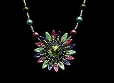 Pendants – Multicoloured sunflower pendant- green tone – a unique product by DarkEyedJewels on DaWanda Handmade Jewellery, Beadwork, Pendants, Brooch, Unique, Green, Etsy, Jewelry, Handmade Jewelry