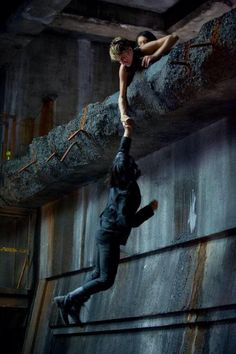 """New """"Insurgent"""" stills reveal Shailene Woodley's Tris saving Zoe Kravitz's Christina while training with other members of the Dauntless faction, while Beatrice's boyfriend Four, played by Theo James, is nowhere in sight. Divergent Fandom, Divergent Trilogy, Divergent Insurgent Allegiant, Tfios, Veronica Roth, Shailene Woodley, Theo James, Story Inspiration, Writing Inspiration"""