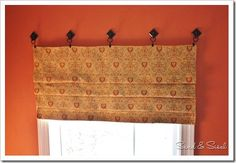 "No sew ""faux"" Roman shade, using self adhesive hooks on top (from Home Depot)."