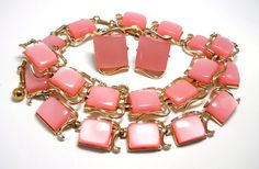 """Vintage Coro Pegasus Pink Thermoset Necklace Bracelet by WeBos, $65.00 A pretty pink moonglow thermoset necklace/choker, bracelet, and earrings; a set from Coro's Pegasus collection.  Necklace is 5/8"""" wide and is adjustable 14-17"""" long. J-hook signed Coro.  Bracelet measures 7/8"""" wide and is 7"""" long. Fold-over clasp signed Coro. Safety chain.  Clip-on style earrings measure 3/4"""" x 1"""". Signed Coro.  Gold tone metal."""