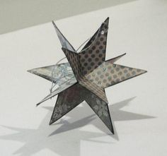 paper star ornaments could sit on book corners in book tree