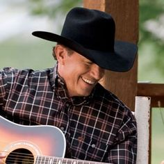 George Strait- he is just so presh! Determined to make it to see him live at some point in my life