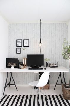 Great black and white simple home office space with modern striped rug