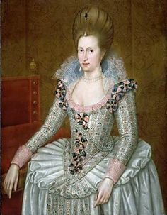 Anne of Denmark wears a bodice with a low, round neckline and tight sleeve, with a matching petticoat pinned into flounces on a drum or cartwheel farthingale, 1605. The high-fronted hairstyle was briefly fashionable.