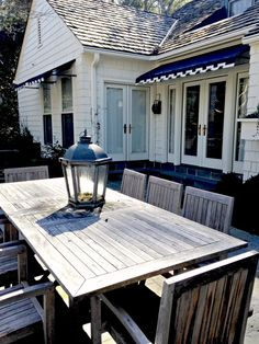 Holly Mathis Interiors: Southern Living under the cover, Teak rectangular table and black awnings