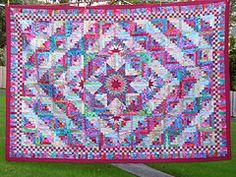 Kaffe Fassett fabrics Starlight Log Cabin quilt designed by Judy Martin. Pattern is in Pieced Borders by Judy Martin and Marsha McCloskey.