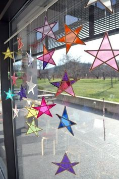Wood and paper stars - a fun craft for kids. These make beautiful sun catchers, too!