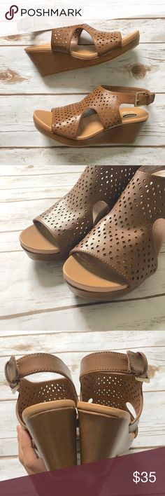 """Dr. Scholl's Camel Cut Out Wedges Feminine and chic camel colored cut out wedge sandals by Dr. Scholl's. ▪️Approximate 2.5"""" heel ▪️Approximate 3/4"""" platform ▪️Adjustable strap at heel ▪️Fits true to size ▪️Purchased new and never worn  🚭 Smoke-free home 📬 Ships by next day 💲 Price negotiable  🔁 Open to trades 💟Happy Poshing!💟 Dr. Scholl's Shoes Sandals"""