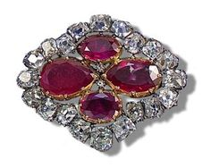 This brooch originally formed part of the ruby and diamond Parure created by Ménière in 1816 to designs by his son-in-law, Evrard Bapst, who succeeded him as Jewellers to the French Crown. The Parure was made using stones from the Empress Marie-Louise's ruby and diamond Parure. Which had been commissioned by Napoleon from François-Regnault Nitot and delivered to the Crown Treasury on 16th January 1811. When the original Parure was dismantled in 1816 the principal rubies and other ornaments…