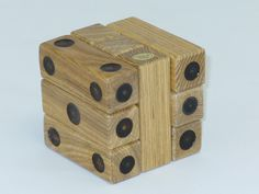 Puzzle Dice, can you take the nine pieces apart and put it back together?