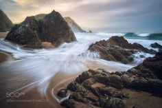 Play of the waves at Praia da Adraga by KaiHornung from http://500px.com/photo/214465221 - I love capturing the play of the waves on a rough and rocky beach with some longer exposures. Each and every wave is different and so I go away from a spot like this with a whole lot of exposures. In the end I look for those lines that fit the image best. Here at the beach of Praia da Adraga not only did I capture the the rough coastline but also the play of the waves.. More on dokonow.com.