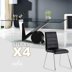 Mesa de comedor moderna en cristal transparente y sillas con costuras decorativas.