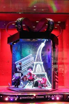 NYC's Best Holiday Windows #refinery29  http://www.refinery29.com/2013/12/58131/best-holiday-windows-nyc#slide-2  This year, the theme of Bloomingdale's windows is holiday celebrations around the world. We see the joy of unwrapping gifts in France...  ...