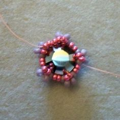 Flower 14. Pick up 2xB and go up through the next B bead.  Pull your thread tight - it is this round that will hold your chaton in place.