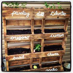 my pallet herb garden Josh made me...still have a few more herbs to add
