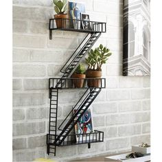 Buy New York Fire Escape Rack in Singapore,Singapore. New York, New York. The humble fire escape is as much an icon of the city as the grand buildings around. Think Holly Golightly singing on the fire escape in Bre Chat to Buy Display Shelves, Wall Shelves, Unique Shelves, Book Shelves, Wall Storage, Unique Bookshelves, Bookshelf Wall, Ladder Shelf Desk, Staircase Bookshelf