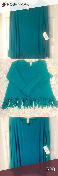 """NWT!! Solid Teal Fringe-Hem Tunic NWT!! Solid Teal Fringe-Hem Tunic Top! Purchased from the popular online boutique """"Giddy Up Glamour"""".  Super cute and comfy as the material has a little stretch to it. This top is a """"boutique"""" size 3X which is numerical size 16/18. Giddy Up Glamour Tops Tunics"""