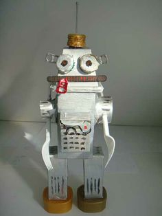making a recycled robot Alien Crafts, Fun Crafts, Crafts For Kids, Recycled Robot, Recycled Crafts, Space Projects, Fun Projects, Make Your Own Robot, Junk Modelling
