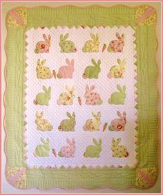 T. in the Burg. The cutest bunny quilt ever ....the carrot motif detail is sweetband the cross hatch quilting really enhances the whole design !