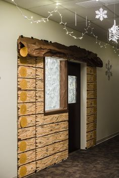 Decorate doorways as cabins with wood-grain paper (available to order online) for #OperationArctic, #vbs2017