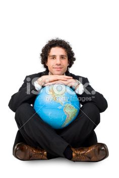 happy successful business man holds world in his hands Royalty Free Stock Photo