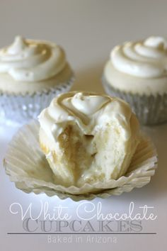 White Chocolate Cupcakes - a melted white chocolate truffle in the center! Baked in AZ