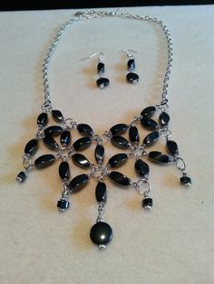 This is a sleek, hematite set in a flower pattern--can go great with just about any outfit.