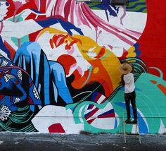 Work in progress by the Brazilian duo Bicicleta Sem Freio in Honolulu Hawaii with @justkidsofficial for @powwowworldwide - Visit them today on 831 Queen Street in KaKa'Ako #streetart #streetartnews @bicicletasemfreio @flash_girl by streetartnews