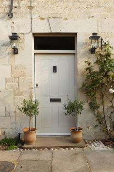 Stony Ground in Farrow & Ball Exterior Eggshell finish creates a stunning entrance in this traditional home. Farrow Ball, Studio Mcgee, Exterior Paint, Interior And Exterior, Craftsman Exterior, Cottage Exterior, Craftsman Style, Free Wallpaper Samples, Wimborne White