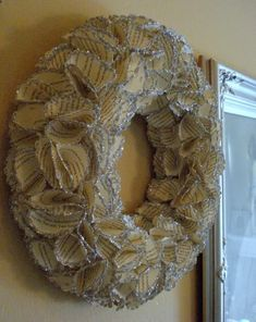 sparkling book page wreath with punch out florettes