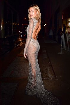 Hailey Baldwin looking seriously smoking in a seriously sparkly full-length, backless dress by Naeem Khan at a party thrown by Carine Roitfeld for Harper's Bazaar