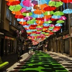 Portugal features an amazing installation of suspended umbrellas in a popular shopping promenade.